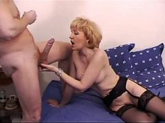 Blonde mom in black stockings has hot sex