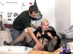 Blonde busty mature woman has sex in office