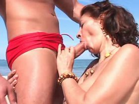 Elder mature sucks cock and has hard fuck on beach