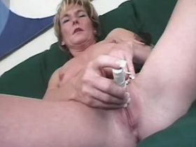 Mature plays with dildo and has oral and fucks on sofa