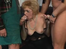 Hungry granny gets hard fuck with two guys in orgy