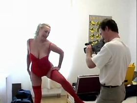 Blond mature in red stockings fucks in doggy style