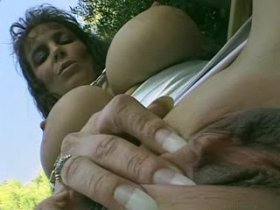 Sexy mature chick with big melons fucks outdoor