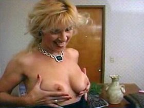 Skinny granny with saggy tits plays with pink dildo