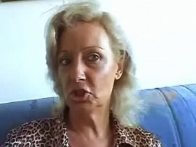 Old ugly slut plays with her big worn cunt on sofa