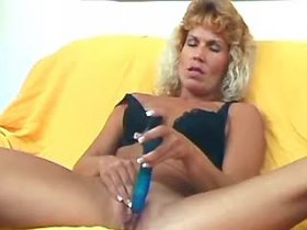 Mom plays with blue dildo and takes dick ride