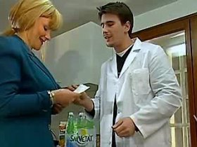 Dirty blond milf blows young doctor in his office