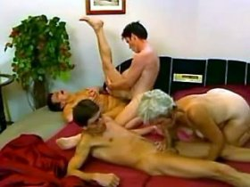 Two young guys bang two old whores senseless in bed