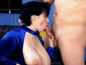 Busty mom gives young guy blowjob and boob fuck