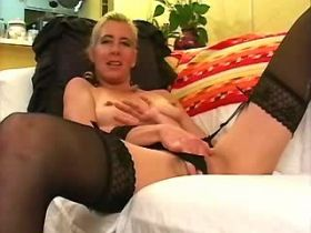Blonde mature plays with dildo and gets cum on pussy