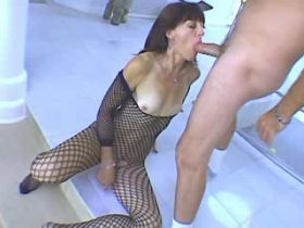 Brunette mature in fishnet gets facial after fuck