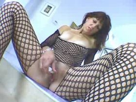 Brunette mature in fishnet sucks cock and fucks