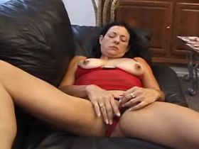 Brunette lewd mature sucks cock and fucks on sofa