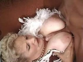 Guy fucks granny with big tits on sofa in all poses
