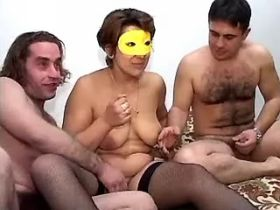 Masked mature sucking and fucking with two guys