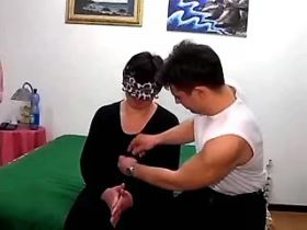 Masked chubby mature sucks two cocks in hot group