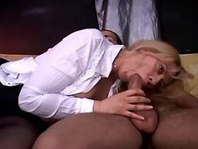 Blonde mature sucking and jumping on cock on sofa