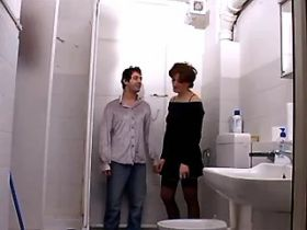 Brunette mature sucking cock and fucking in toilet