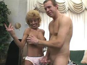 Blonde busty milf sucks cock and fucks from behind