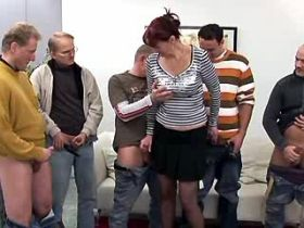 Lewd mature in black stockings sucks dicks in orgy