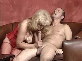Blond chubby mature fucks on table and gets facial