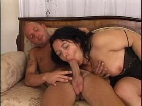 Chubby mature fucks on sofa and gets cum on tits