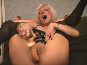 Elder blonde mature gets oral sex and fucks on sofa