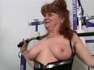 Hot grandma with big tits makes sex in gymnasium